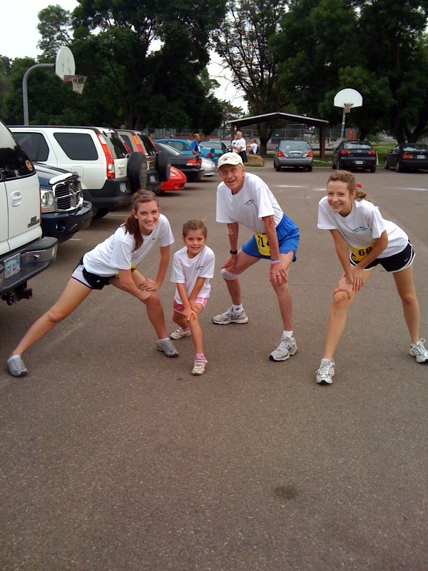 Livy stretches out with Grandpa and cousins Rachel and Emma before the race