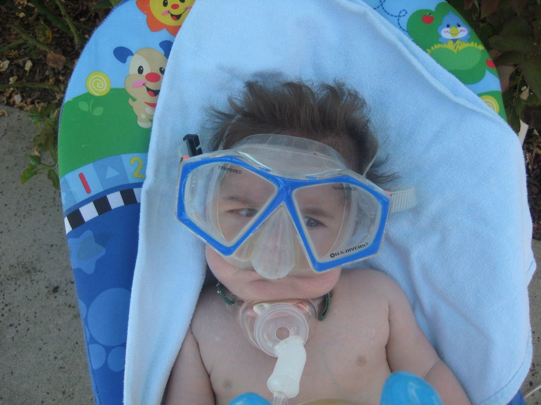 Our new family favorite!!!  Olivia staged this treasure right before she took a dip in the pool...Rudy watched from poolside in awe.  Once the trach is out, I bet Rudy will learn how to swim before he learns how to walk!!!  CLASSIC!