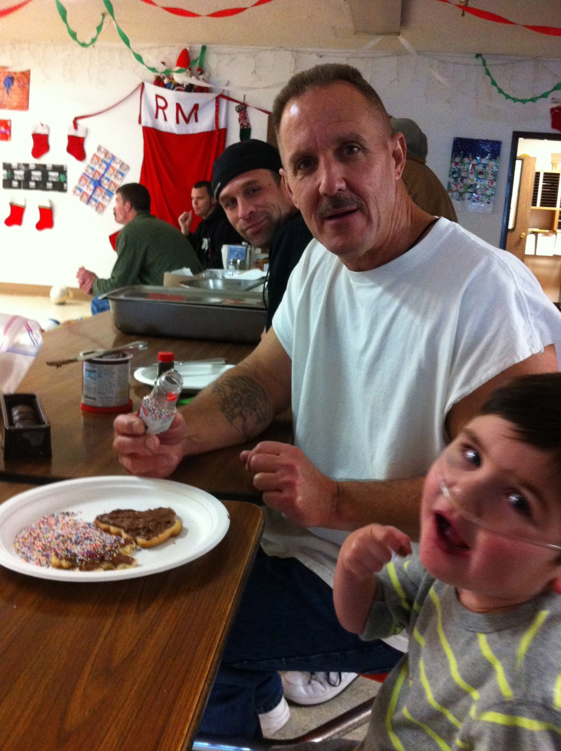 Rudy and friends decorating Christmas cookies at the Rescue Mission.