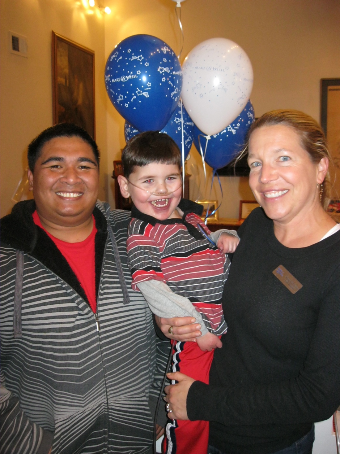 Wish granters Anne and Joseph share the fun with Rudy!