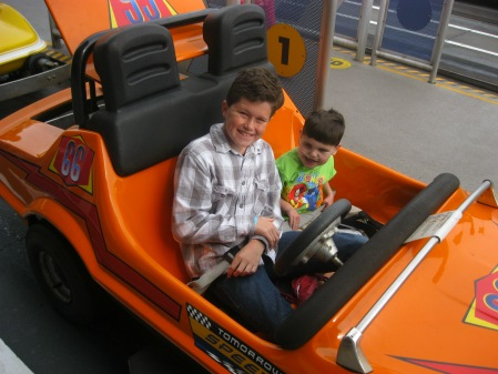 "We spent our last ""theme"" park day at the Magic Kingdom...Rudy REALLY liked the Tomorrowland Speedway!"