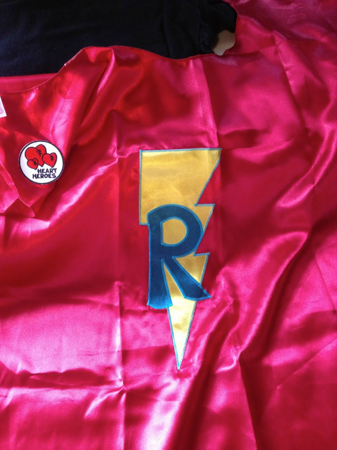 "Powercapes.com sent Rudy this cool ""Heart Hero"" cape to wear to doctor appointments and procedures!  Fun idea!"