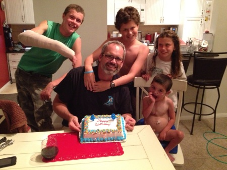 After being away with Olivia for a 2-day soccer tournament and in the ER with Wilson the evening he got back, we finally got to have a belated birthday celebration for the man of the house...complete with a Carvel ice-cream cake!  By the looks of it, Olivia wasn't too keen on the shirtless action of her brothers!