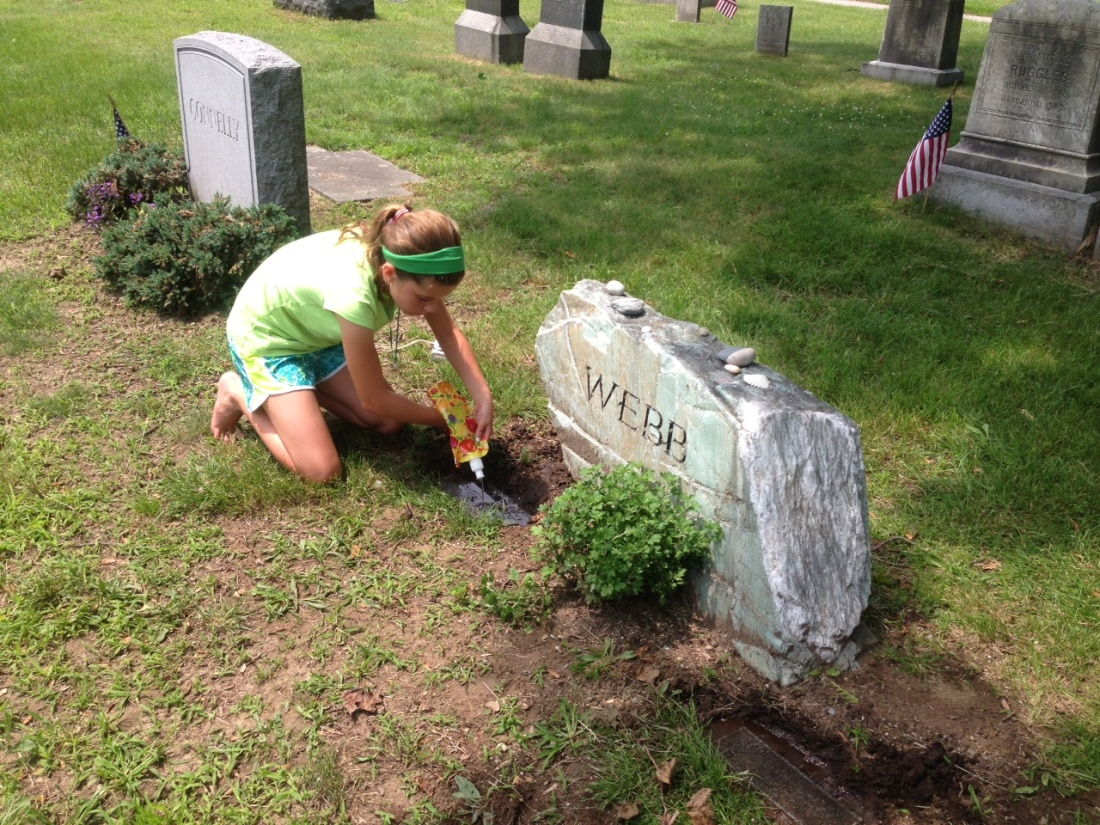 Olivia paying her respects to cousins Seamus and Faoileann laid to rest outside Boston.