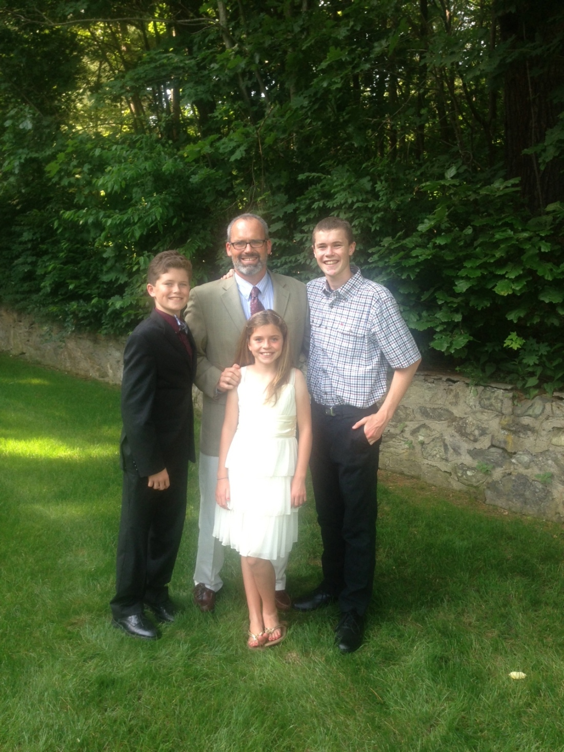 Rolf and the big sibs in Boston all cleaned up and ready to go to a wedding!