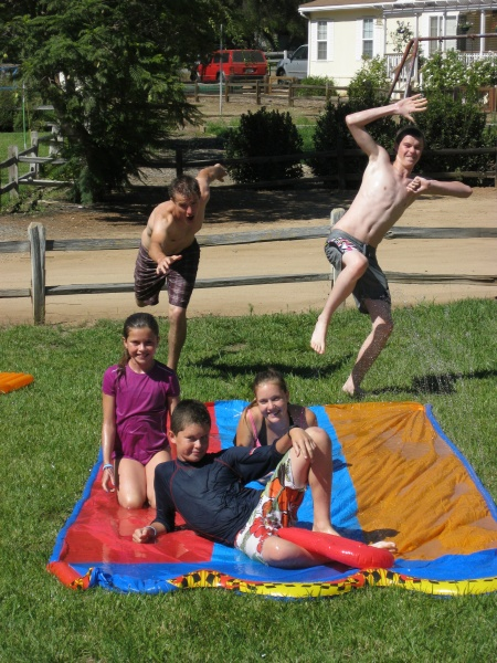 "The fun continued at camp with the Vans!  Nothin' says ""summer fun"" like a slip 'n slide!  (with CeCe and Luke)"