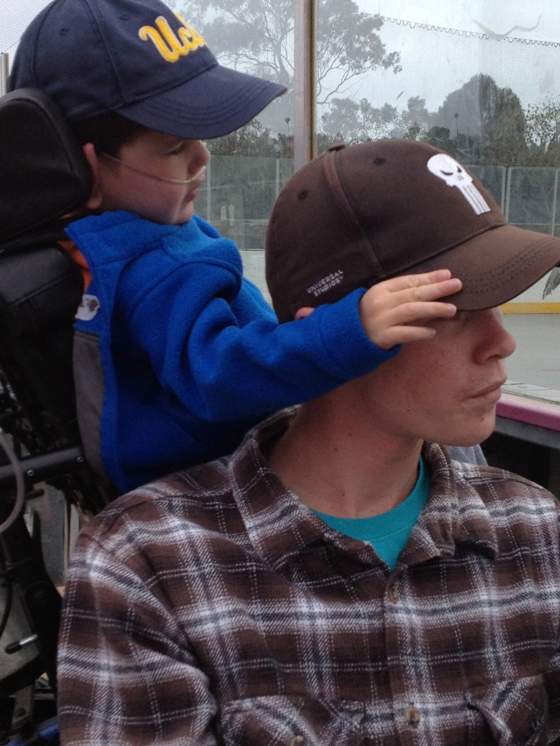 Wilson and Rudy watching Maxo's hockey game last Friday...Heart Walk Eve