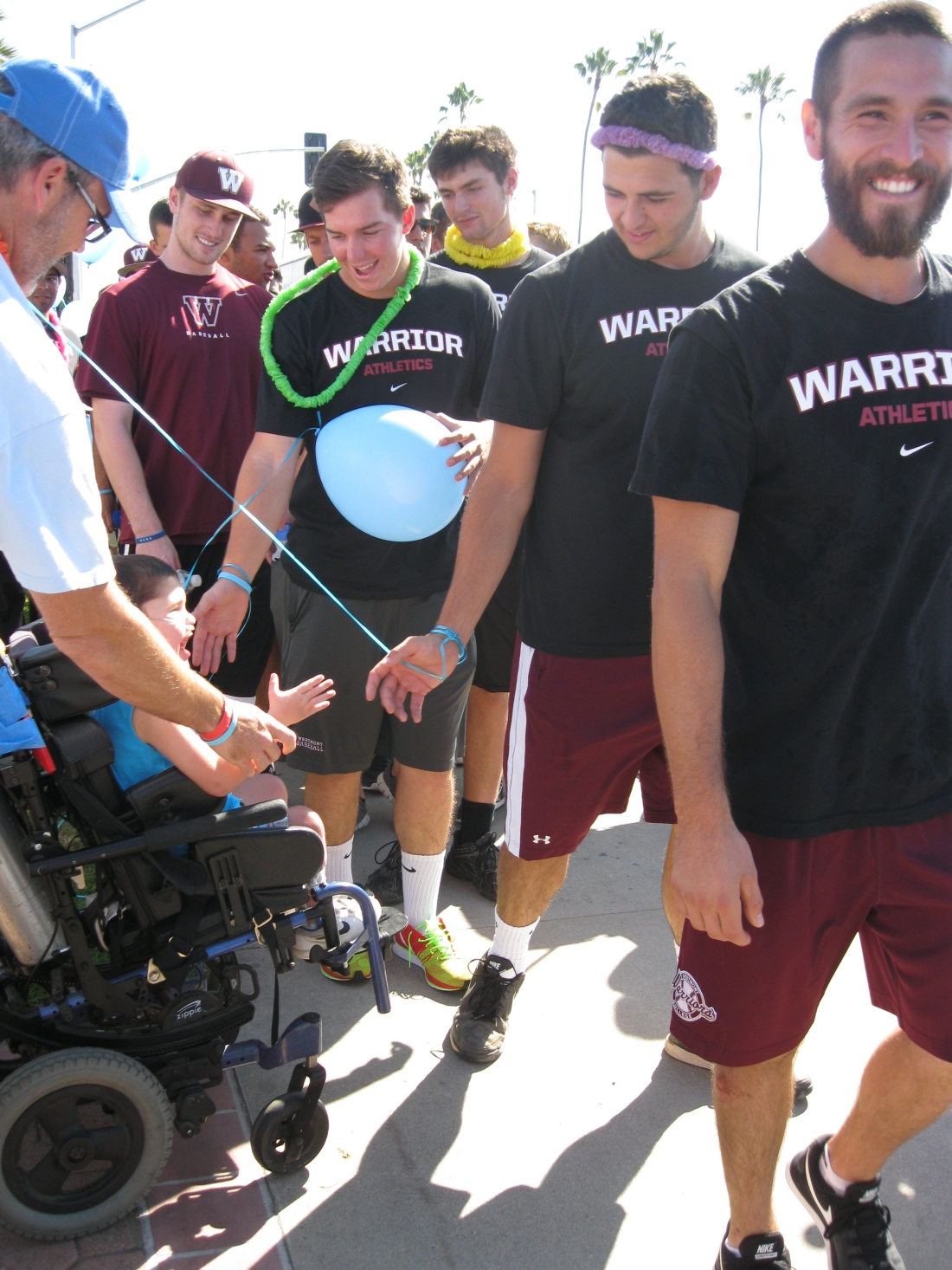 High fives for all the Westmont Warriors at the start of the walk!