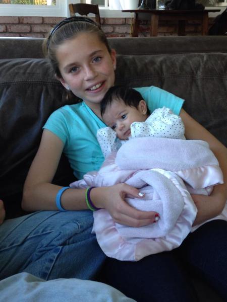Olivia holding brand new baby Olivia!!