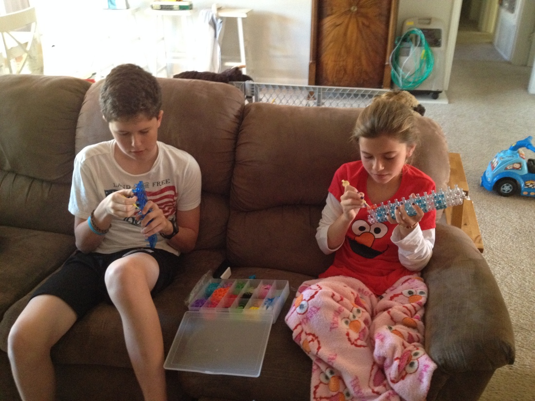 Simple vacation fun…Max trying his hand at Rainbow Looming!...