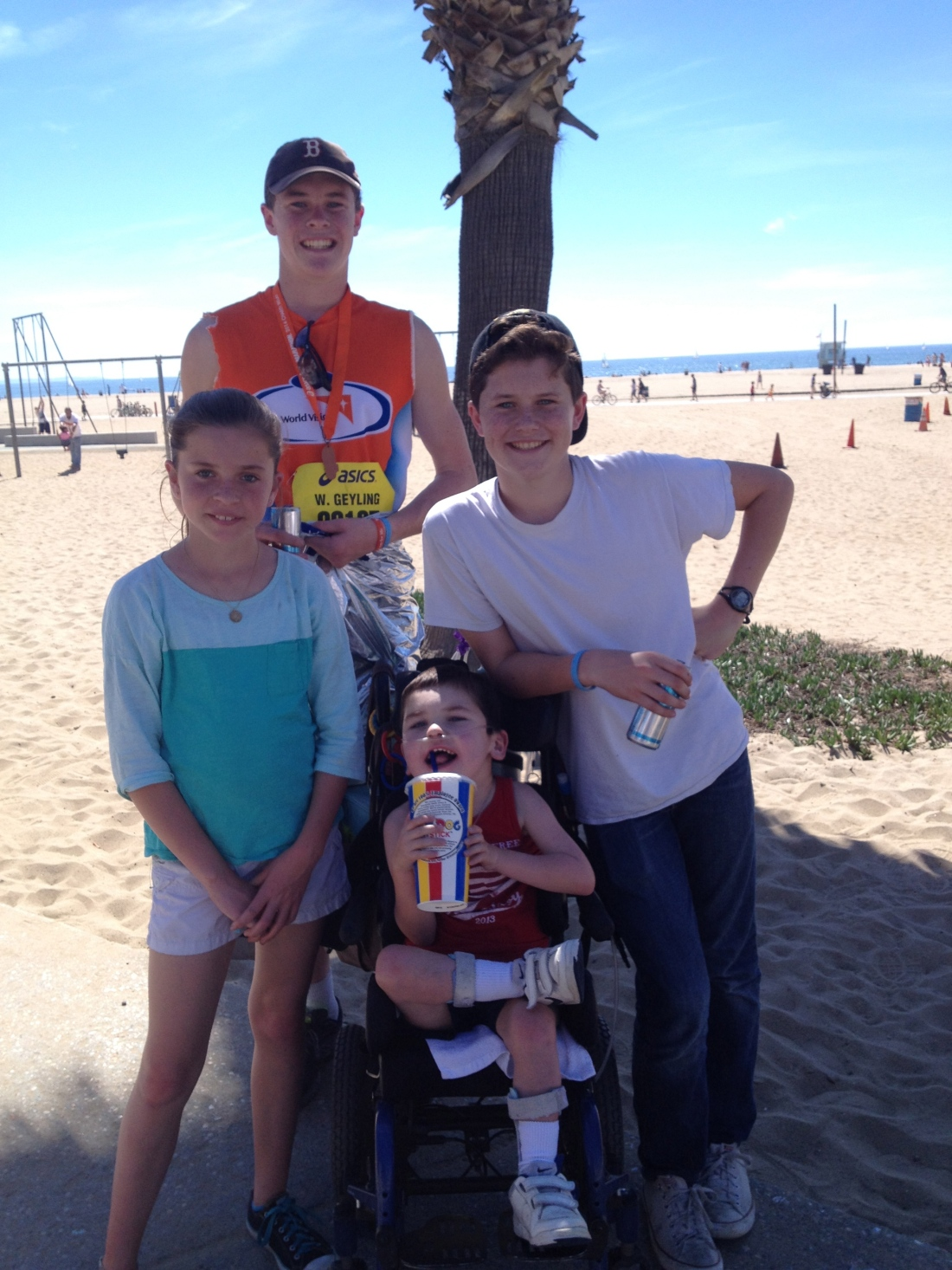 Wilson's 1st 1/2 marathon was a success...the younger sibs were great cheerleaders!