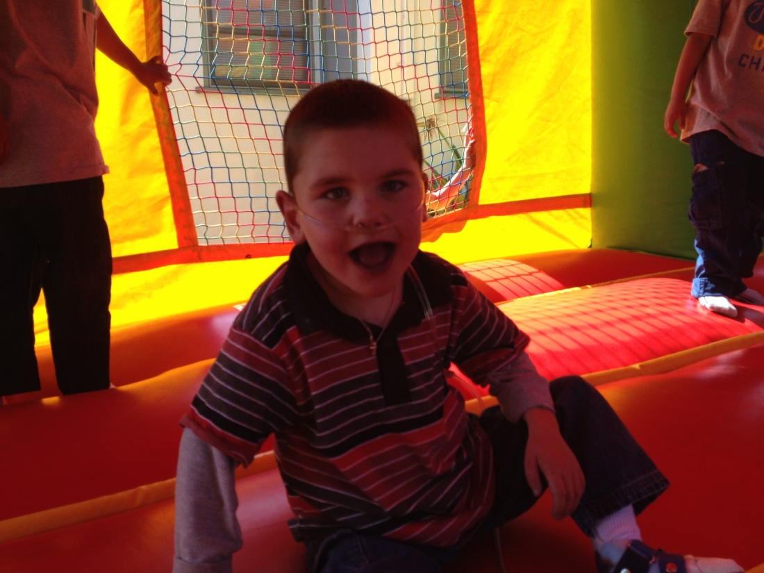 Rudy enjoying the bounce house at a classmate's bday party...