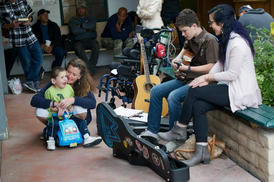 Easter Feast at the Rescue Mission...playing and singing for the homeless guests in the courtyard as they waited...Max and I loved having Olivia (a student from Westmont) join us!