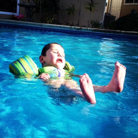 It's official!  Swim season is upon us and with the pool a comfortable 85 degrees...it's warm enough for Rudy to enjoy too!  Without the trach stoma, Rudy can enjoy a little independent pool time and he's taking every advantage of having a pool in the backyard!  Ha Ha