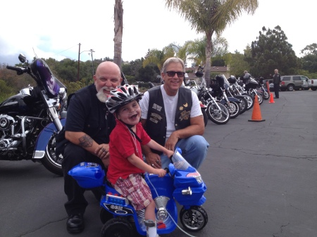 Chillin' with the Black Sheep Harley Club at church!  Rudy was pretty proud of his hog among the lineup of Harleys...