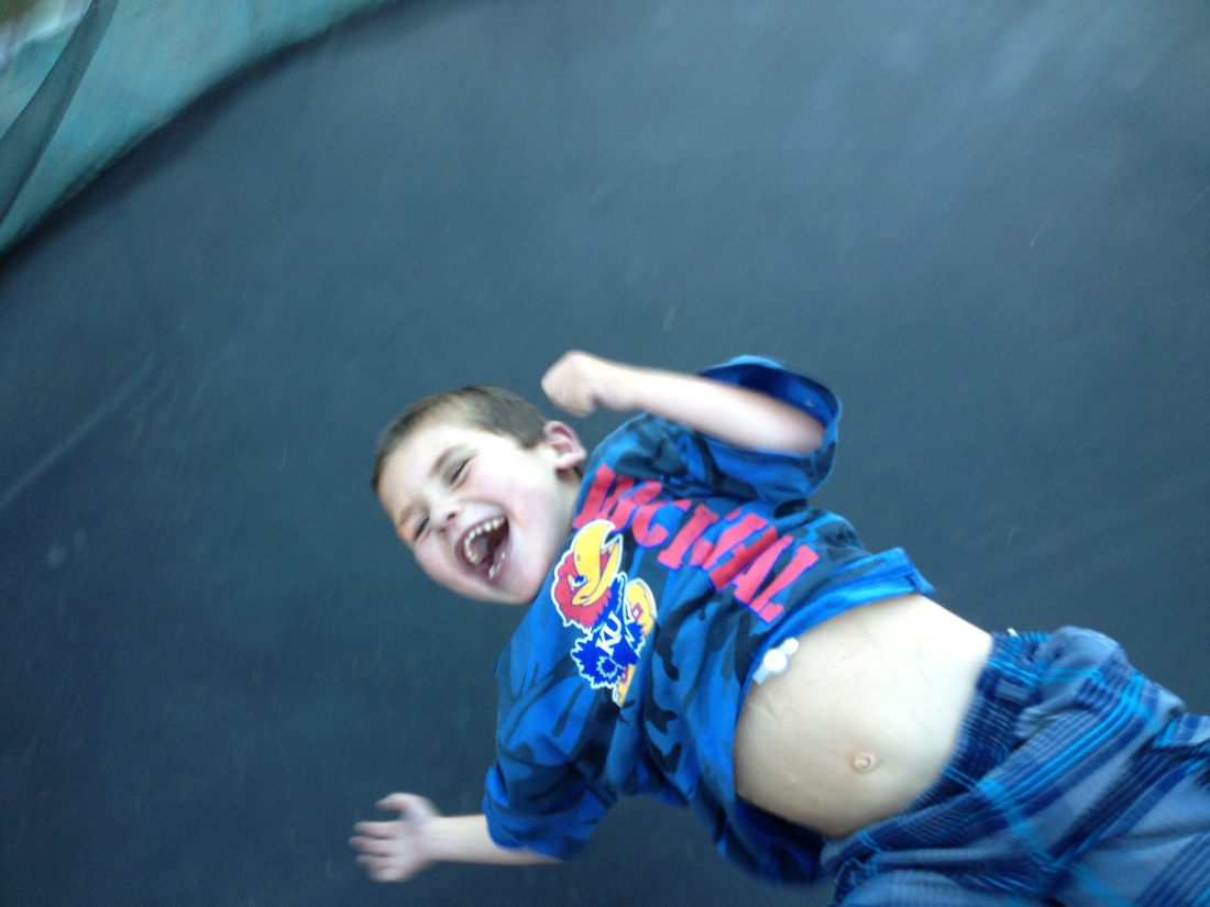 Wilson had some fun with Rudy on the trampoline a few weeks ago…it's a good thing I wasn't aware of how high Wilson was bouncing Rudy or he probably would have missed out on some BIG fun!!  Look at that smile!!...