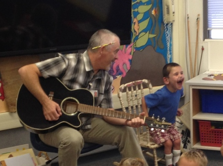 Rudy taking GREAT joy in assisting Mr. Casady during song time!