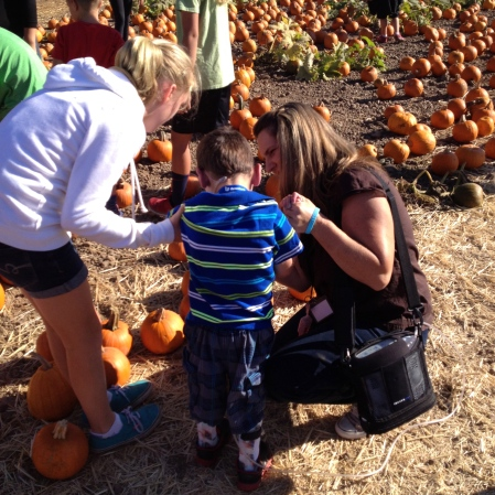Big buddy Natalie and Nurse Sara helping Rudy pick out a pumpkin!!