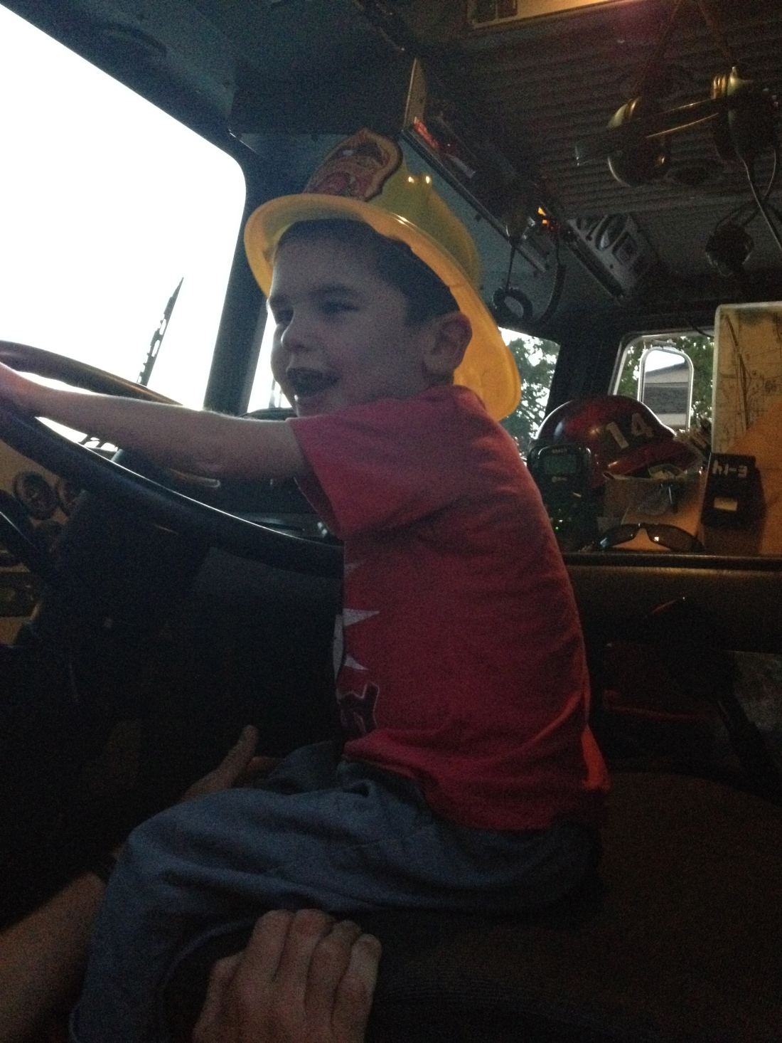 A visit to our neighborhood fire station to drop off some treats led to a turn in the engineer's seat!!  Woo Hoo!