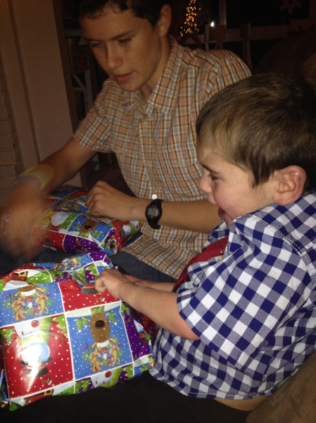 Opening the traditional Christmas eve gift of pajamas!