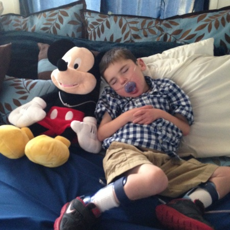 Rudy rarely falls asleep during the afternoon if he's NOT in his own bed but he fell asleep on this day while watching Mickey Mouse WITH Mickey Mouse!  Work hard, Play hard, Sleep hard…that's how Rudy rolls!