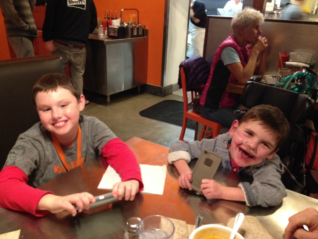 Our new favorite hang out in town is Kyle's Kitchen…you should come visit us and we'll take you there.  Kyle (pictured here with Rudy) is a buddy from school.  His parents (successful restauranteurs here in town) opened this burger joint in Kyle's honor…every month they highlight a different local special needs program or organization and donate a portion of their proceeds to that organization!  Love this sweet family…Love Kyle…LOVE the food!!!