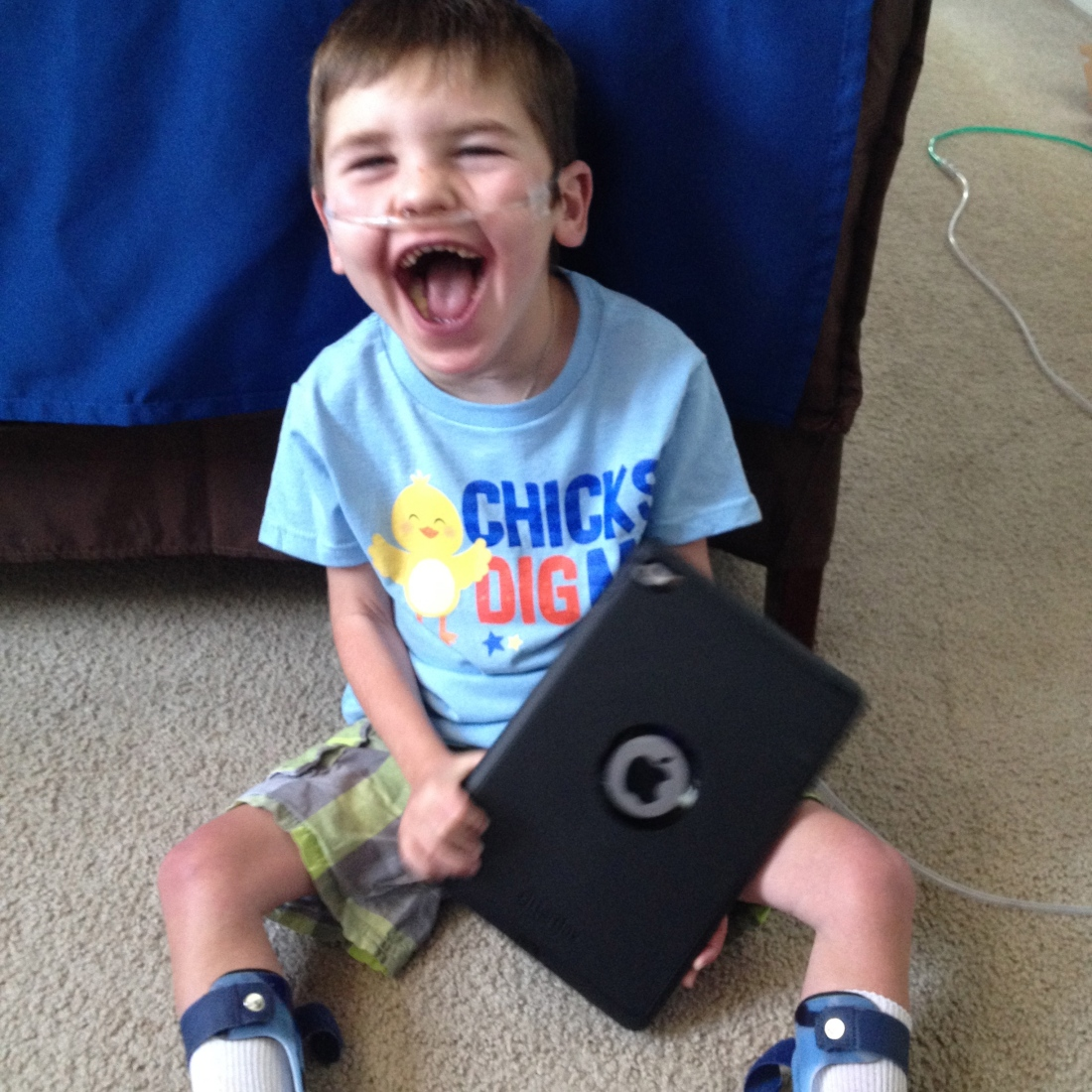 Apparently, a boy + an IPad = a big smile