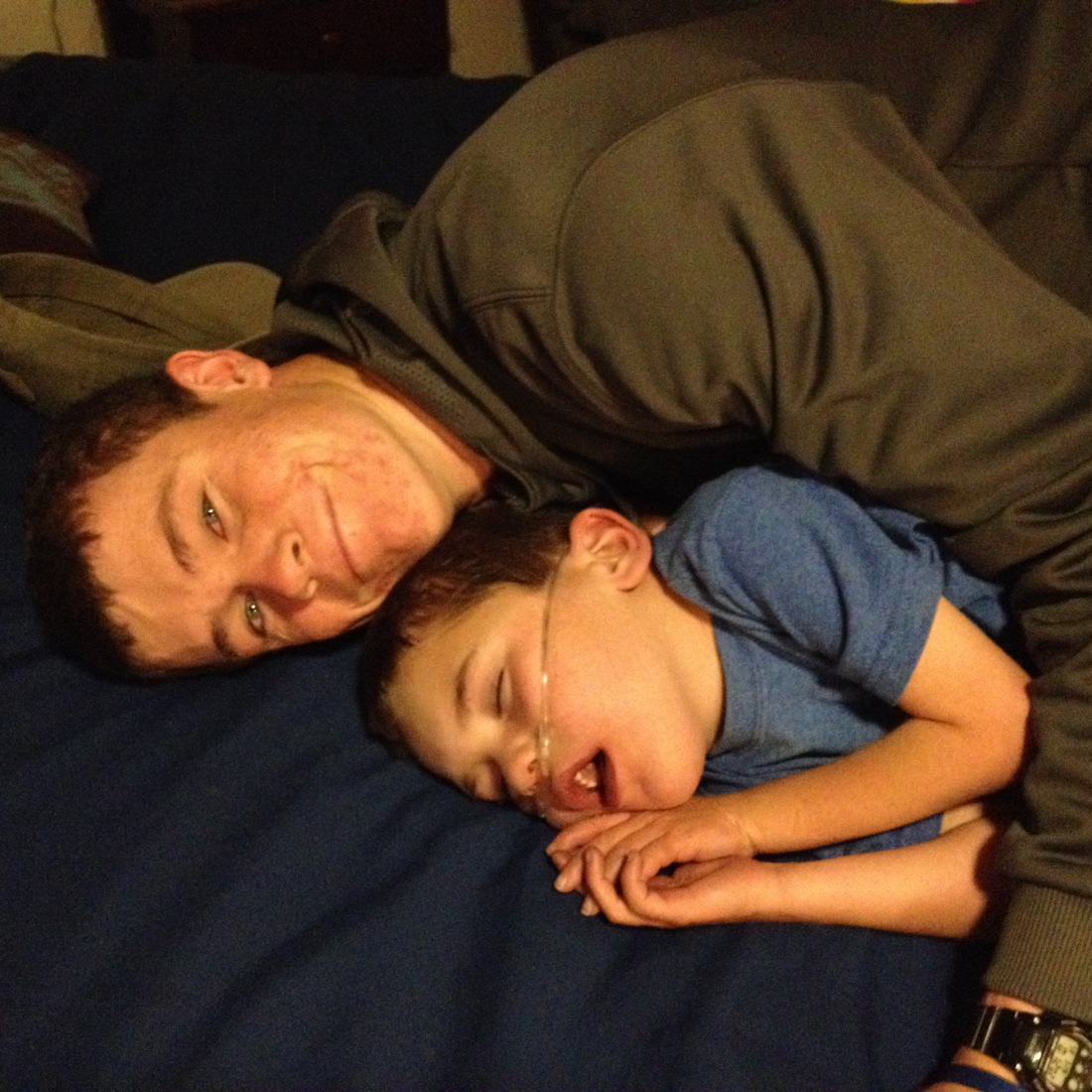 Wilson's late night return from a college visit…1st stop?  Steal a hug from a sleeping Rudy.