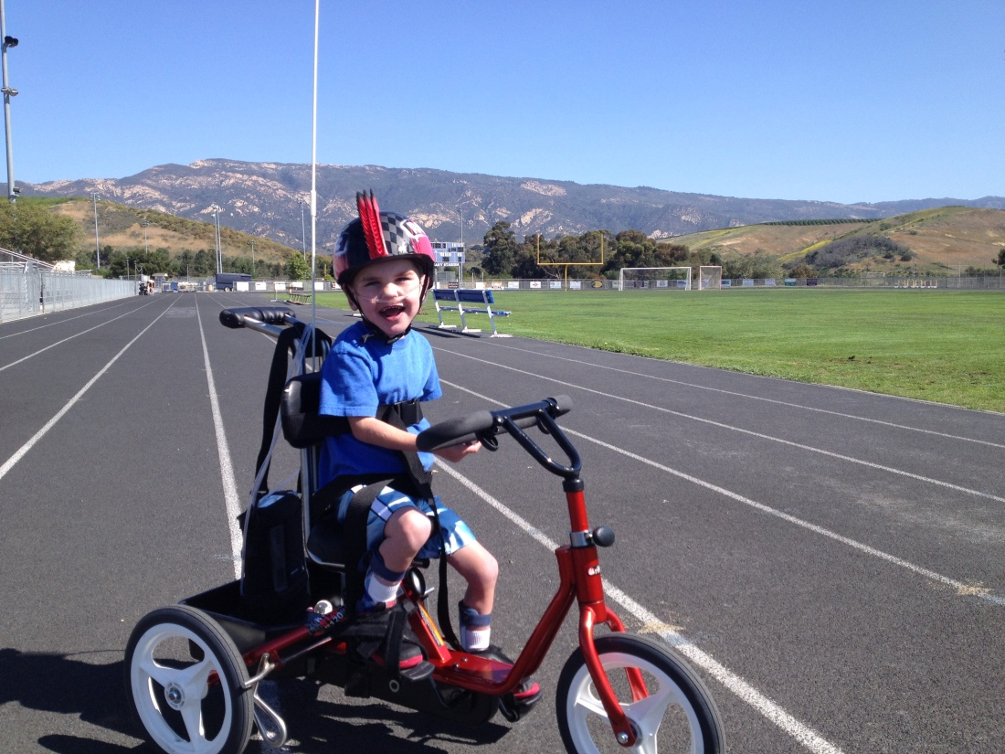 It didn't take long for Rudy to master peddling AND stirring!  He made his way around the high school track TWICE - a 1/2 mile - on his third venture out on his custom trike.  Amazing!!!