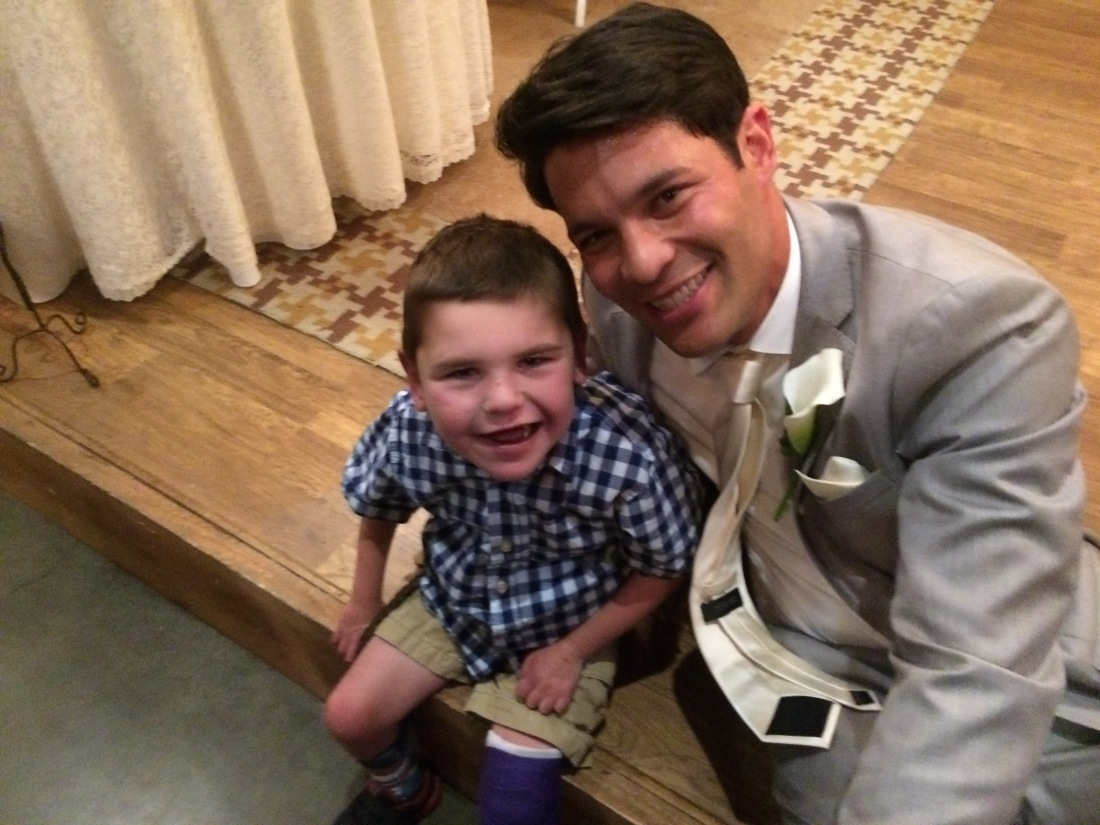 Rudy hadn't quite mastered walking with his cast yet so he had to skip the dancing this wedding but he had fun celebrating Pastor Aaron and his new bride Paige nonetheless!!  Woo Hoo!!  :)