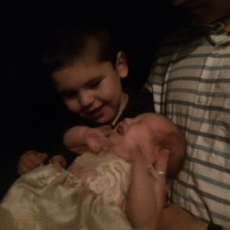 Rudy getting acquainted with the bride's brand new niece...Baby Evie!