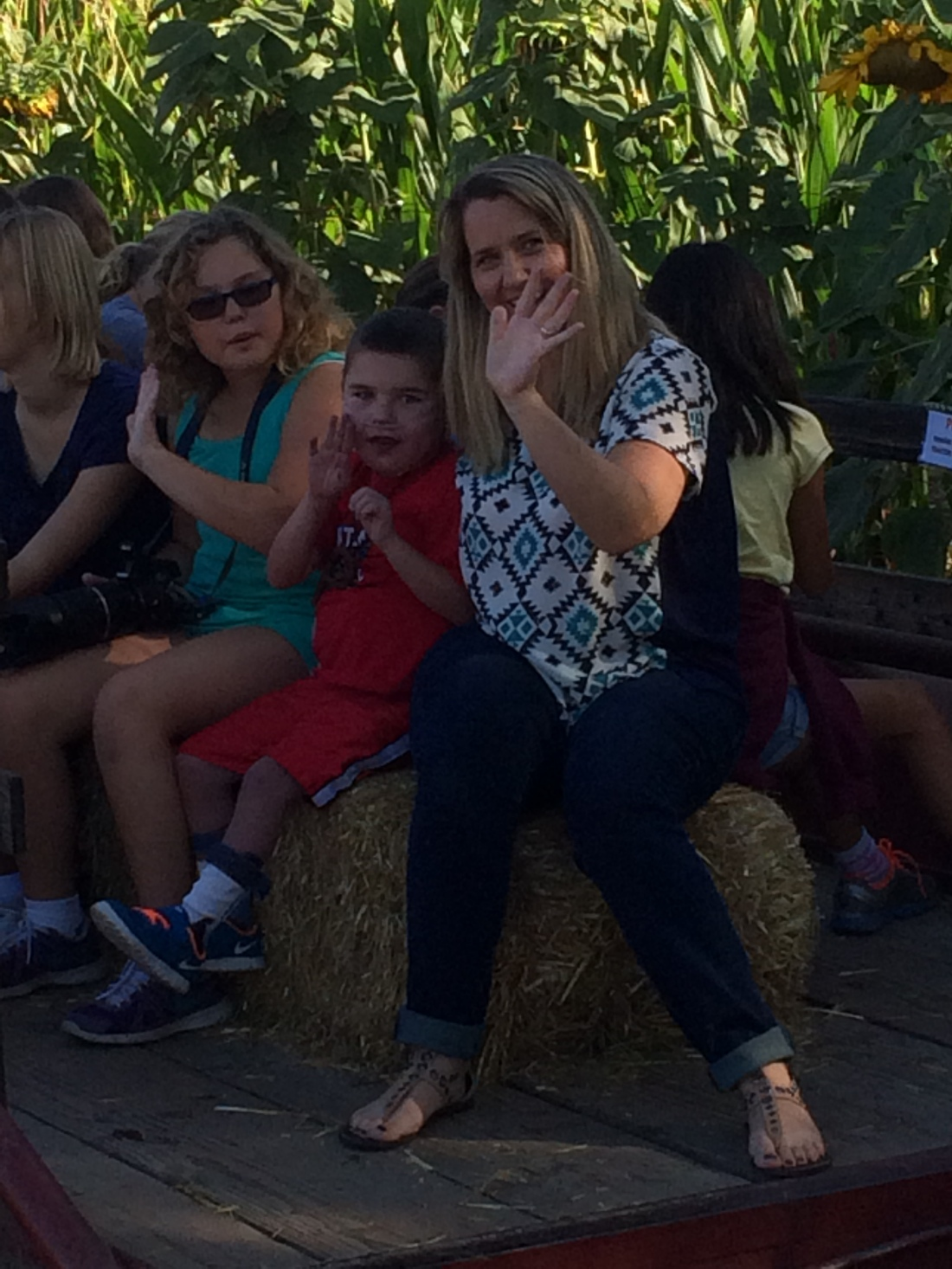Rudy and Nurse Sara and big buddies having fun on the hay ride.