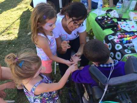 Friends Paige and Ava helped steady Rudy's hand during a session with the face painter! :)