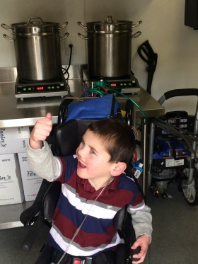 Rudy LOVES the soup at Kyle's Kitchen and got to see how it's made...thumbs up from Rudy!!!